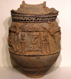 Large Yunnan storage jar decorated as grain store, two guardians, door, beams and roof - courtesy R&G McPherson Antiques